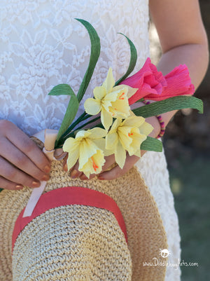 paper daffodils and tulips with a straw hat