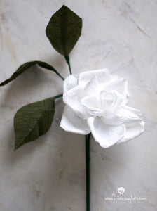 white crepe paper gardenia with leaves