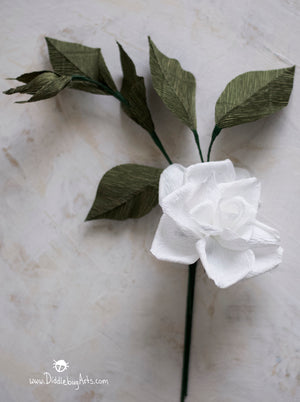 white crepe paper gardenia with leaves and bud attached