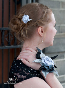 book page mini paper rose in the hair of a girl going to the prom along with her paper wrist corsage