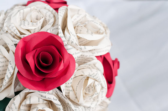 close up of wedding bouquet book page roses and red paper roses