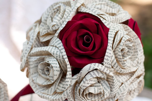 red sueded paper roses and book page roses in a bridal bouquet
