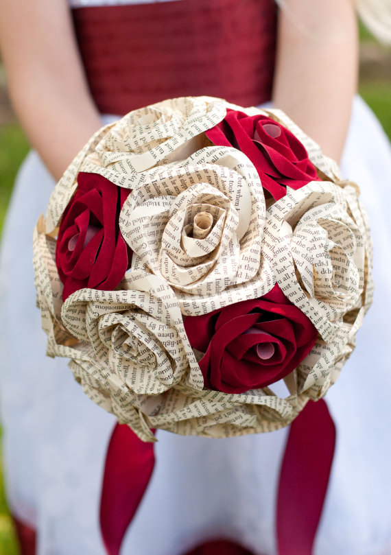 wedding bouquet with red velvet roses and book page roses