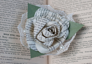 book page paper rose with lace corsage pin on
