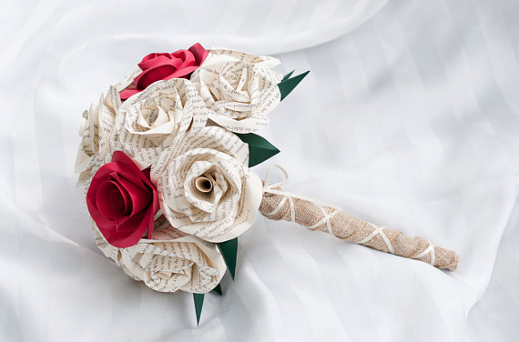side view with handle of wedding bouquet with book page and red paper roses