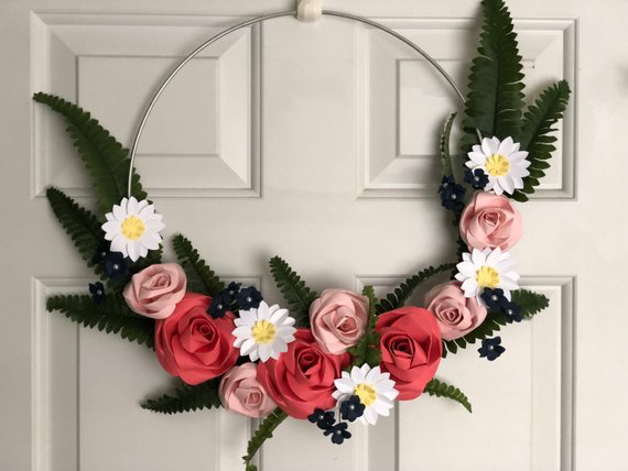 wall decor wreath paper roses, daisies and ferns on a wall