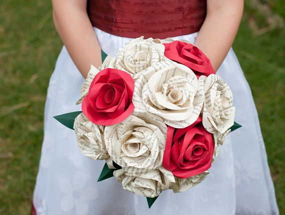 literature and red paper bridal bouquet held by a girl