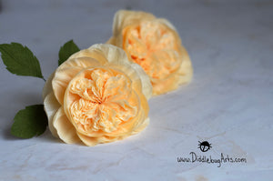 Two paper yellow roses