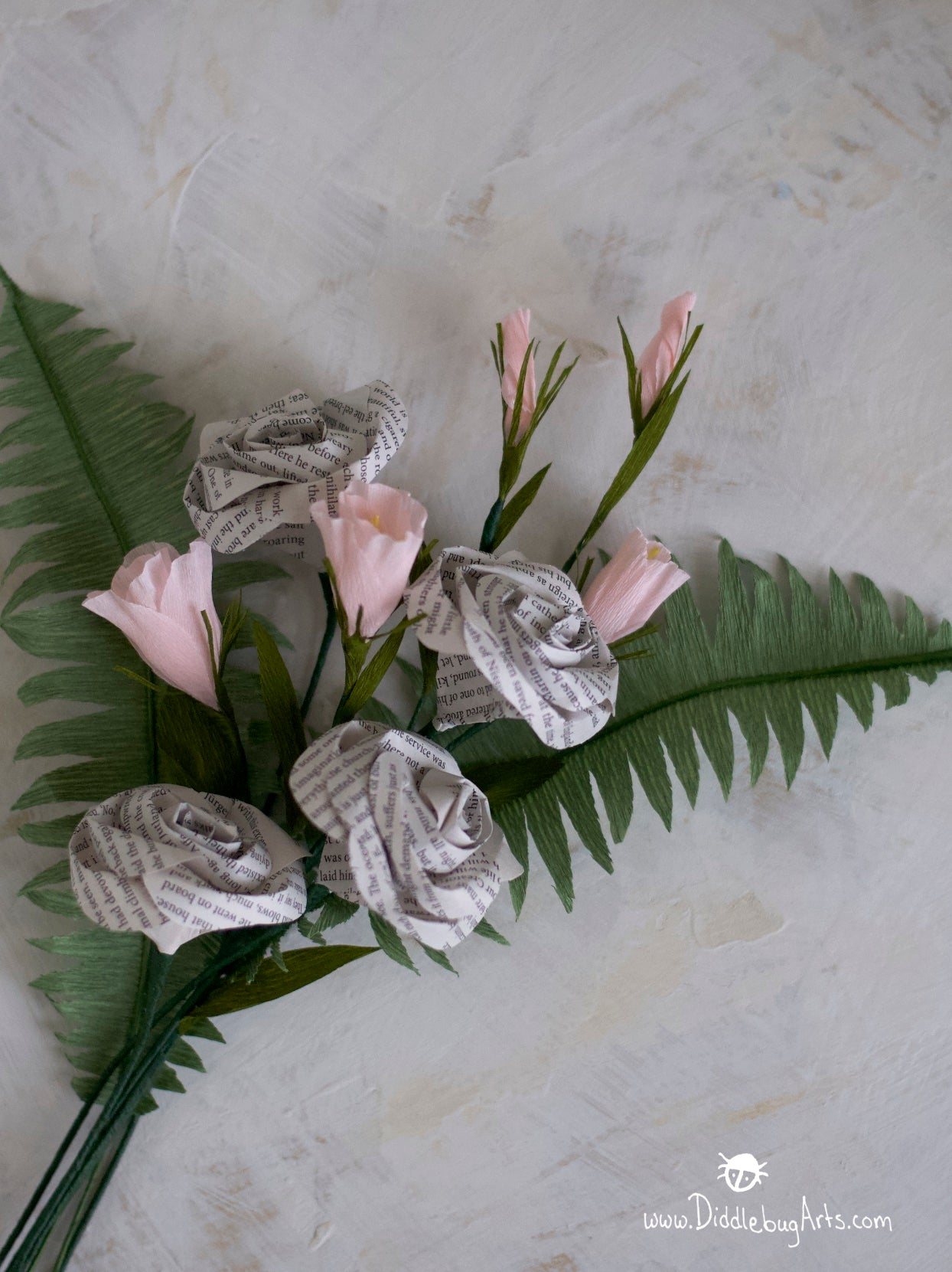 crepe paper lisianthus stem with paper ferns and book page roses