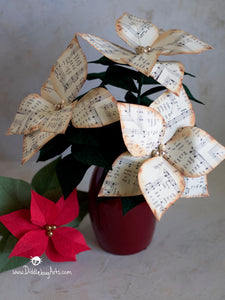 paper poinsettia flowers made out of Christmas Carols