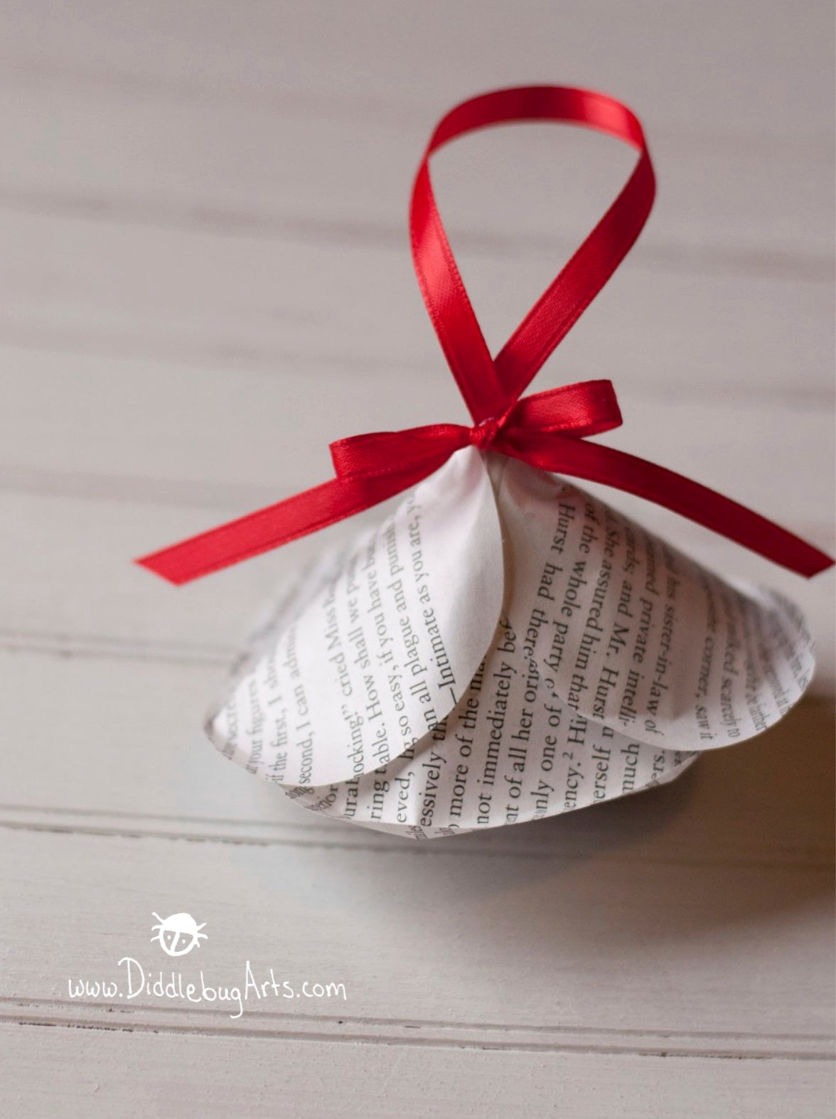red ribbon with a paper book page rose christmas ornament