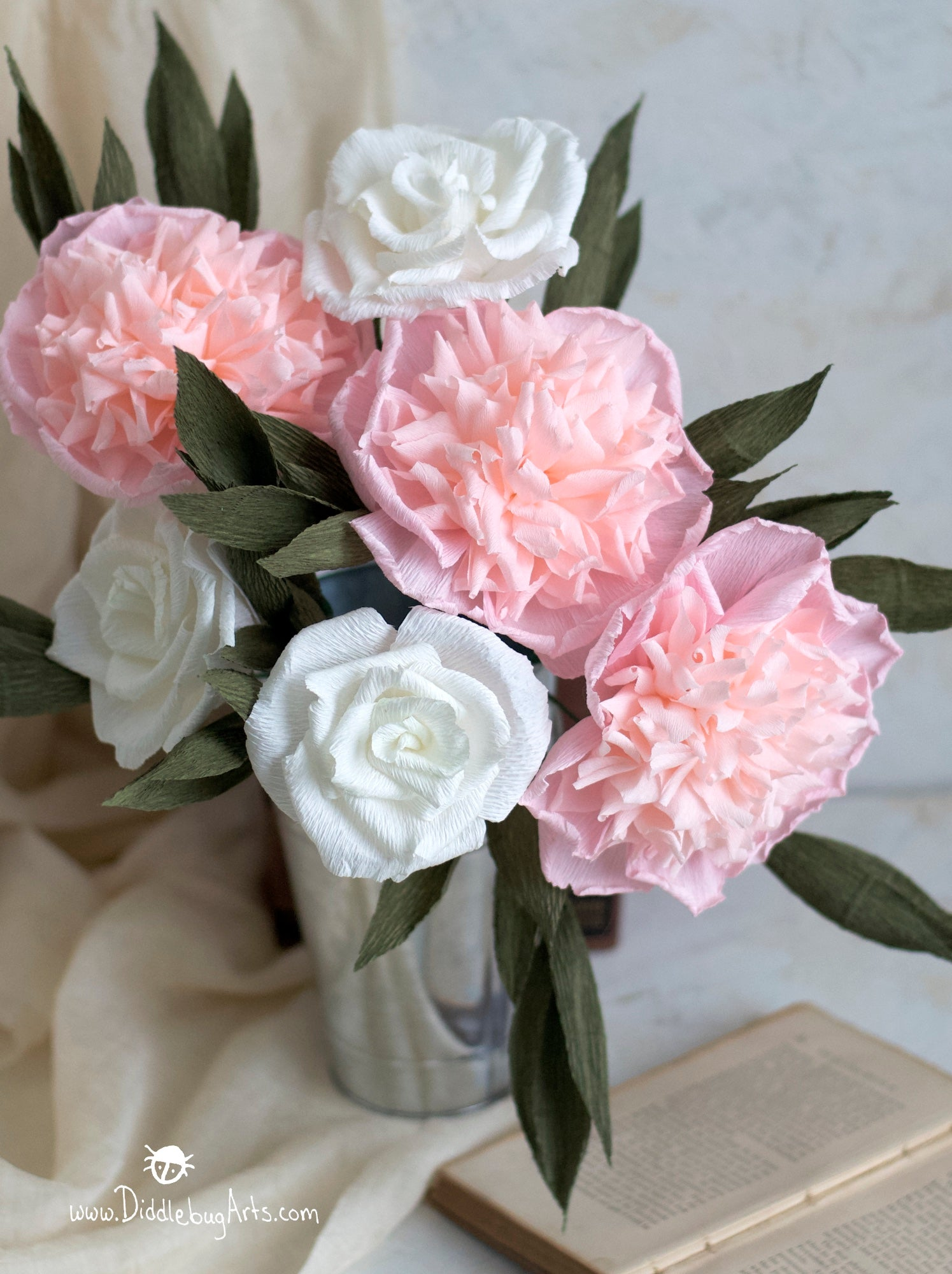 vase with pink paper peonies and white roses