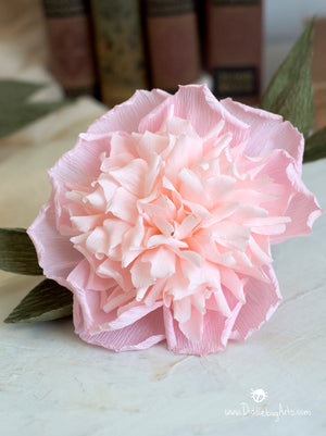 close up of a pink peony made from crepe paper