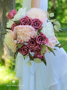 pink peonies and plum roses in a bridal bouquet