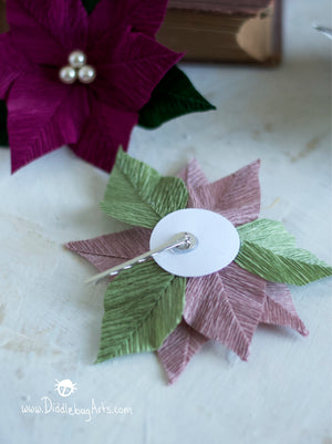 showing the hair pin back of the crepe paper poinsettia