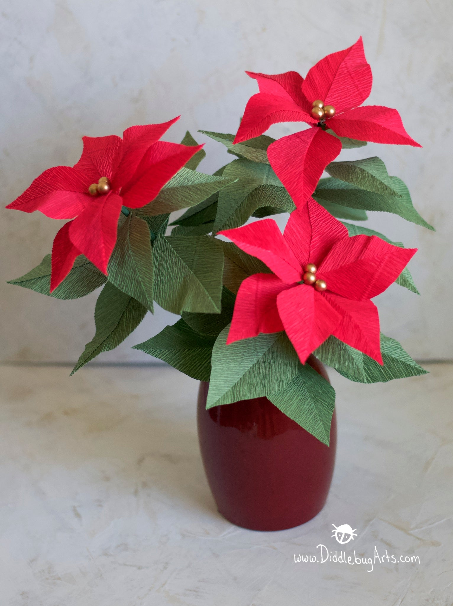 red crepe paper poinsettia plant