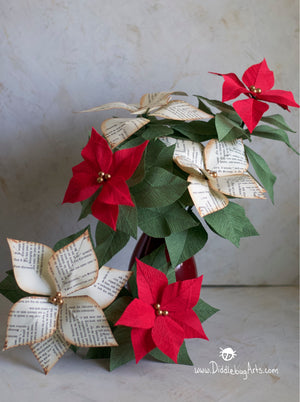 mass of book page and crepe paper poinsettia plants