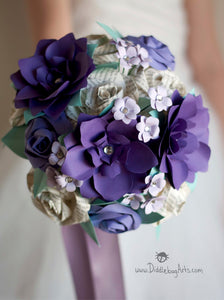 purple paper gardenias and book page roses in a bridal bouquet