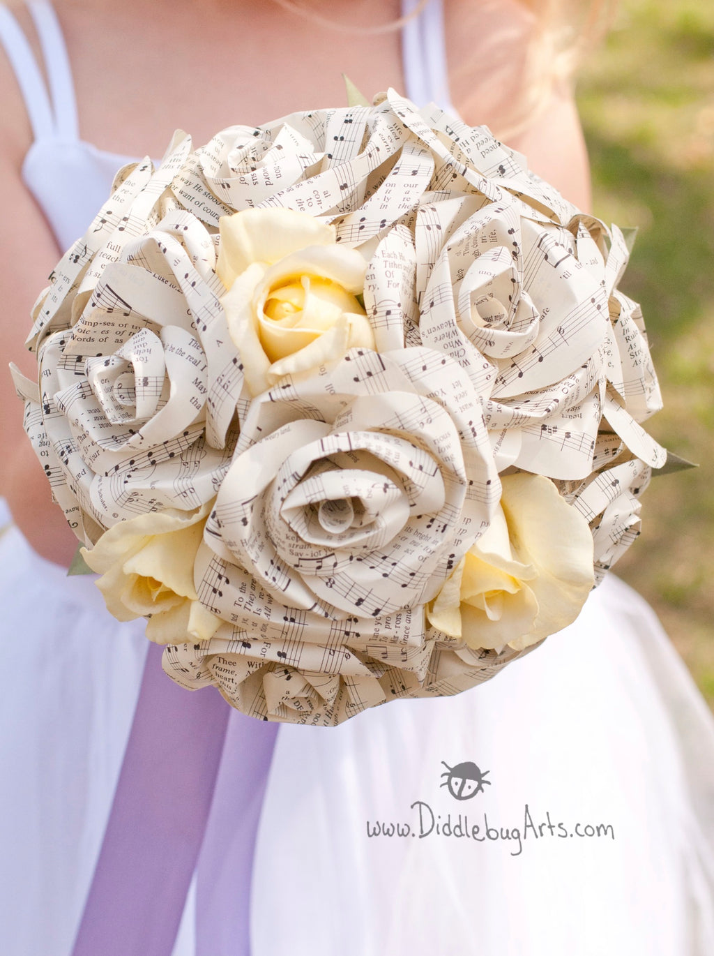 Sheet music or Book Page and Silk Rose Bouquet