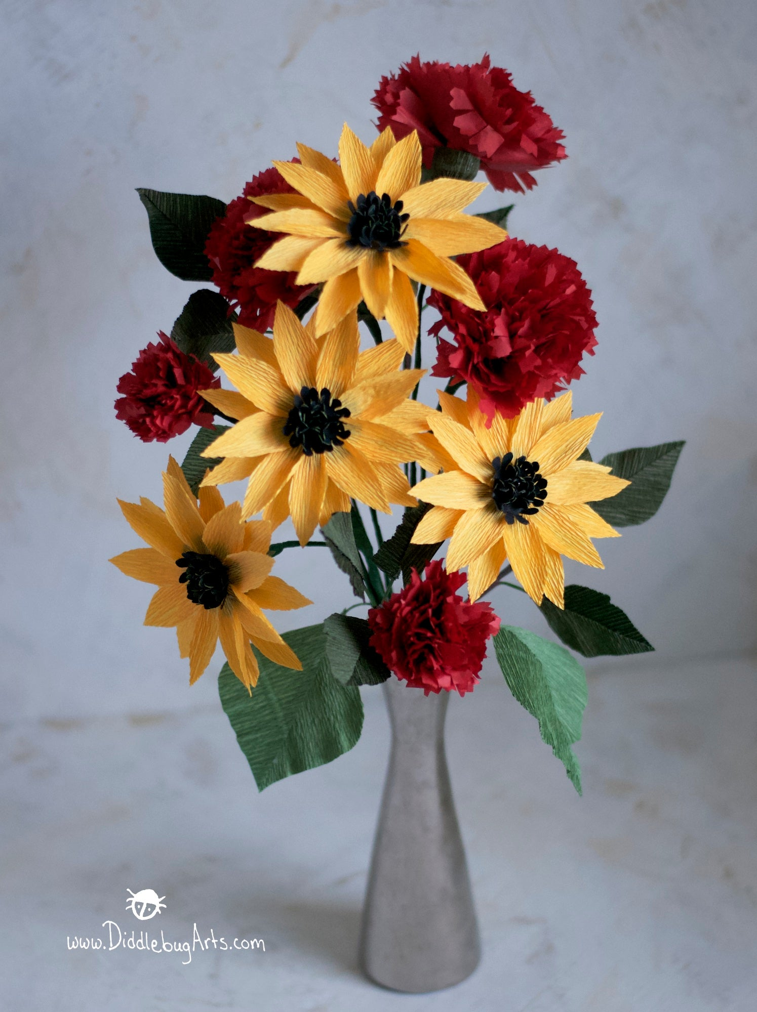 yellow paper sunflowers and red paper carnations