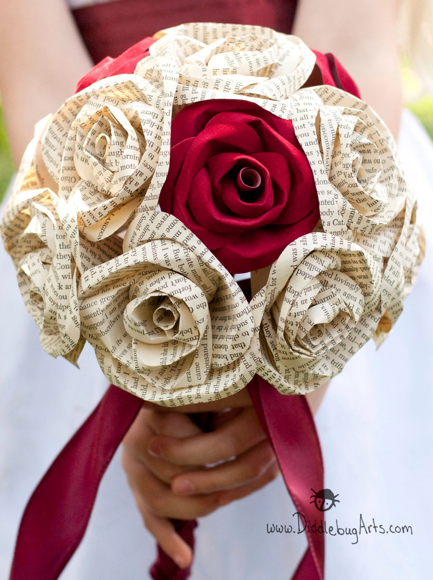 bridal bouquet with book page and red sueded roses