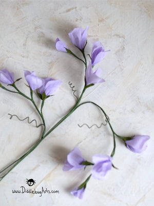 crepe paper sweet pea flowers in purple