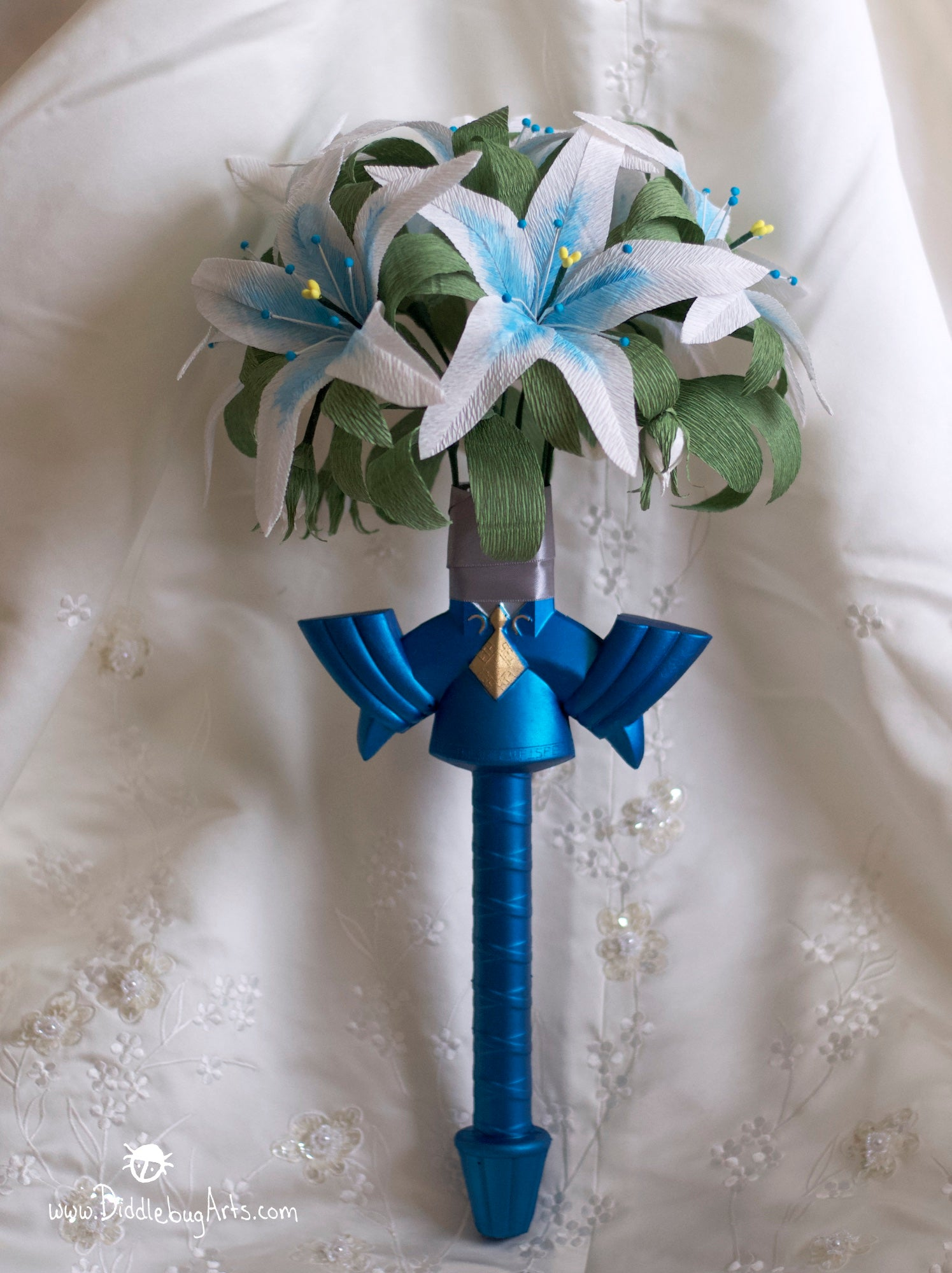 master sword hilt from Legend of Zelda video game with paper flowers wedding bouquet