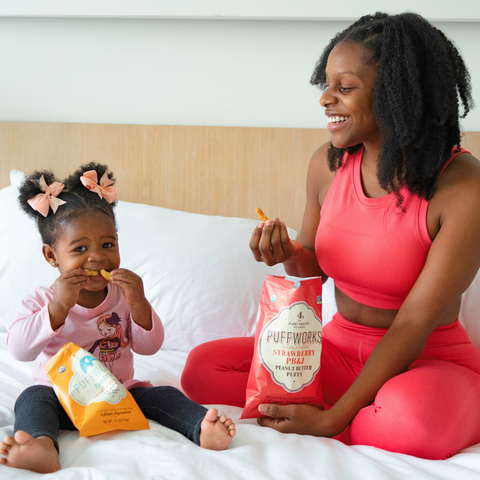 Woman with Daughter Sharing Puffs