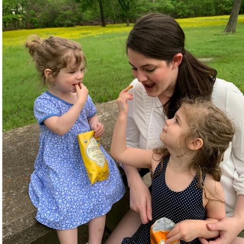 mom with daughters eating Puffworks