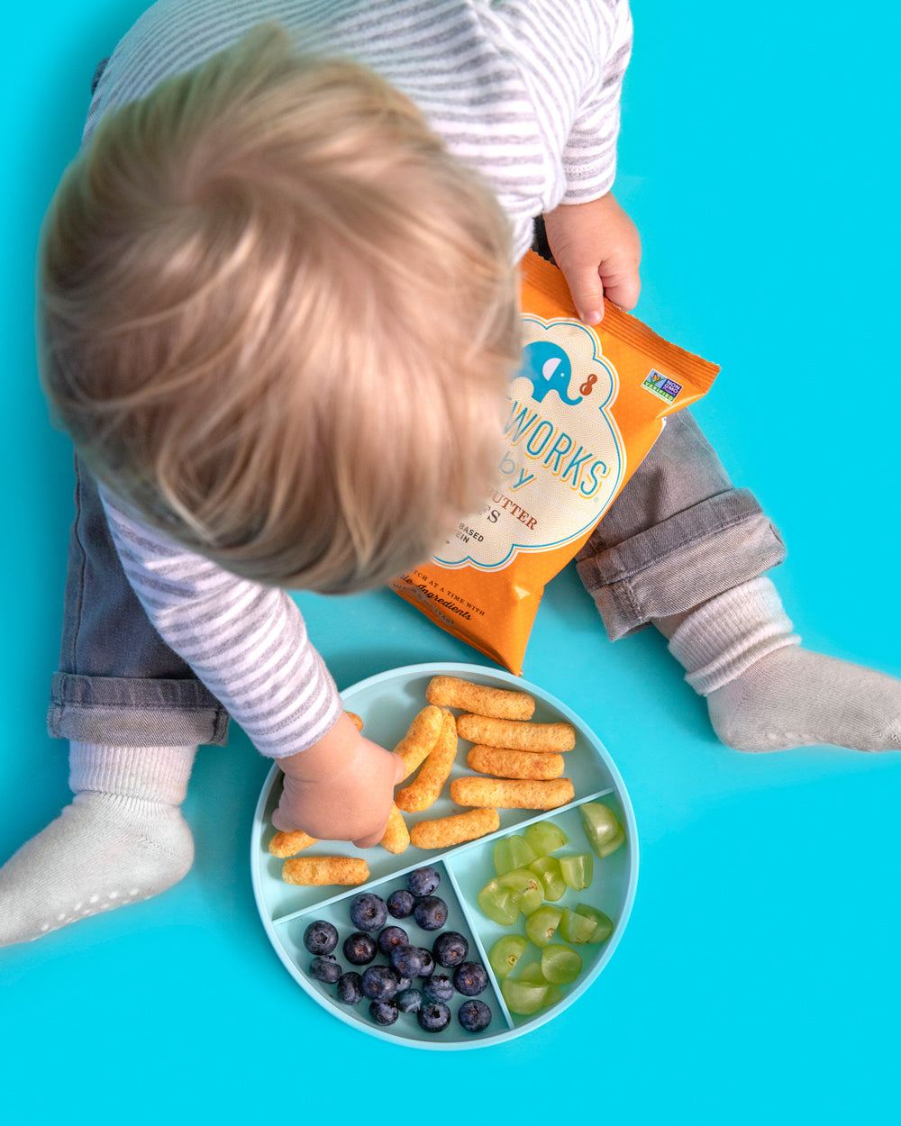 Baby enjoying Puffworks Baby Peanut Butter Puffs