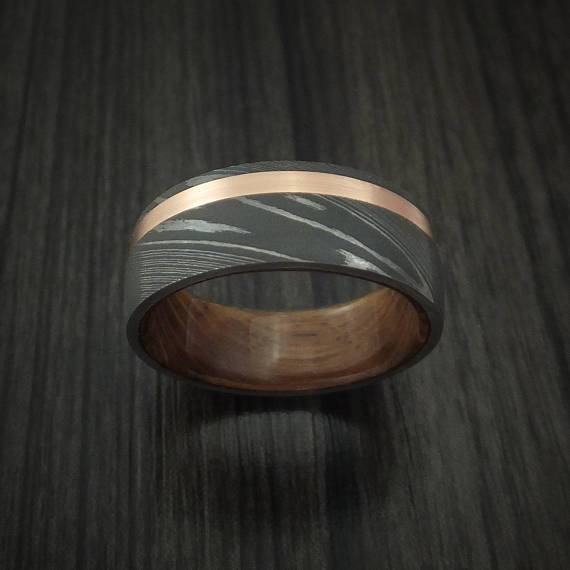 Damascus steel band with 14k rose gold and jack daniels whiskey barrel wood sleeve custom made