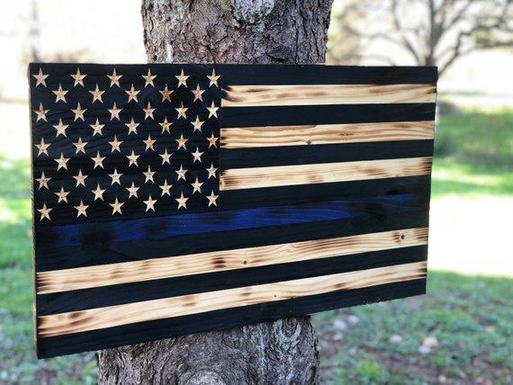Rustic wooden American Flag with a thin blue line