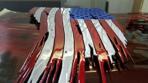 Tattered and Torn American flag metal art. aluminum. Do not buy a steel one, it will  rust. Available in both painted and unpainted