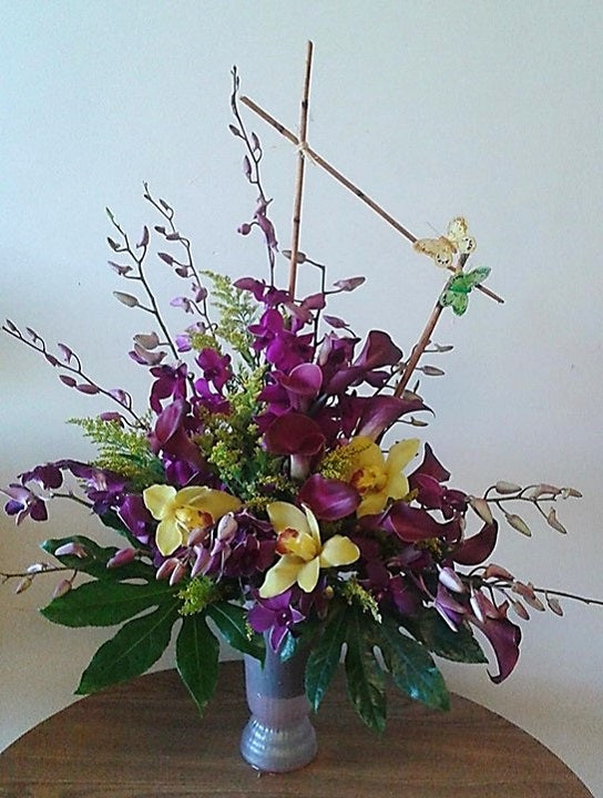 GLW148 - MIXED ORCHIDS AND CALLAS WITH GREENERY AND DECORATIVE DETAIL