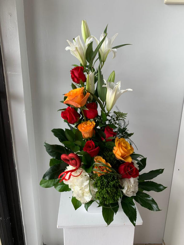 GLW132 - RED AND ORANGE ROSES, LILLIES, HYDRANGEAS, GREENERY AND DECORATIVE DETAIL