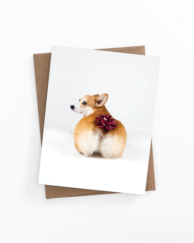Birthday greeting card of a risque corgi butt with a present bow by LaCorgi.