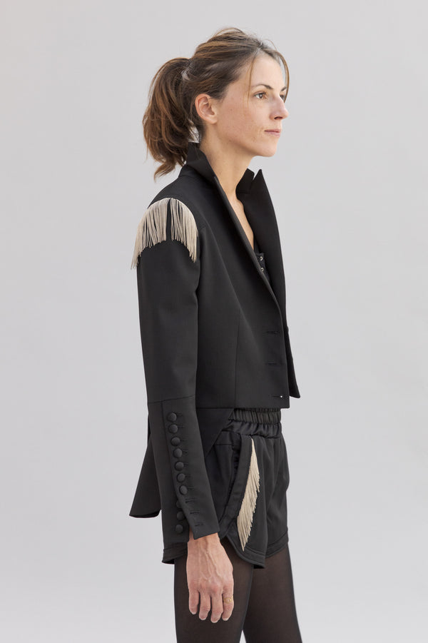 SARAH DE SAINT HUBERT satin black jacket made of virgin wool with hand embroidered chains. Feminine rock'n'roll silhouette.