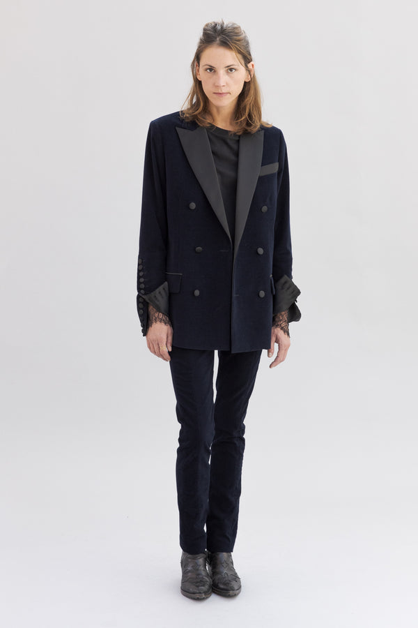 SARAH DE SAINT HUBERT navy double breasted boyfriend tailored jacket of ribbed velvet with signature extra-high buttoned cuffs with satin covered buttons. Boyfriend and straight fit.