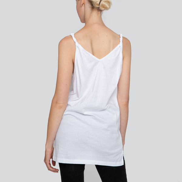 SARAH DE SAINT HUBERT white printed 'Love her Wild' slogan tank top made of cotton jersey with twisted shoulder straps and v-neck line. A timeless piece and relaxed fit.