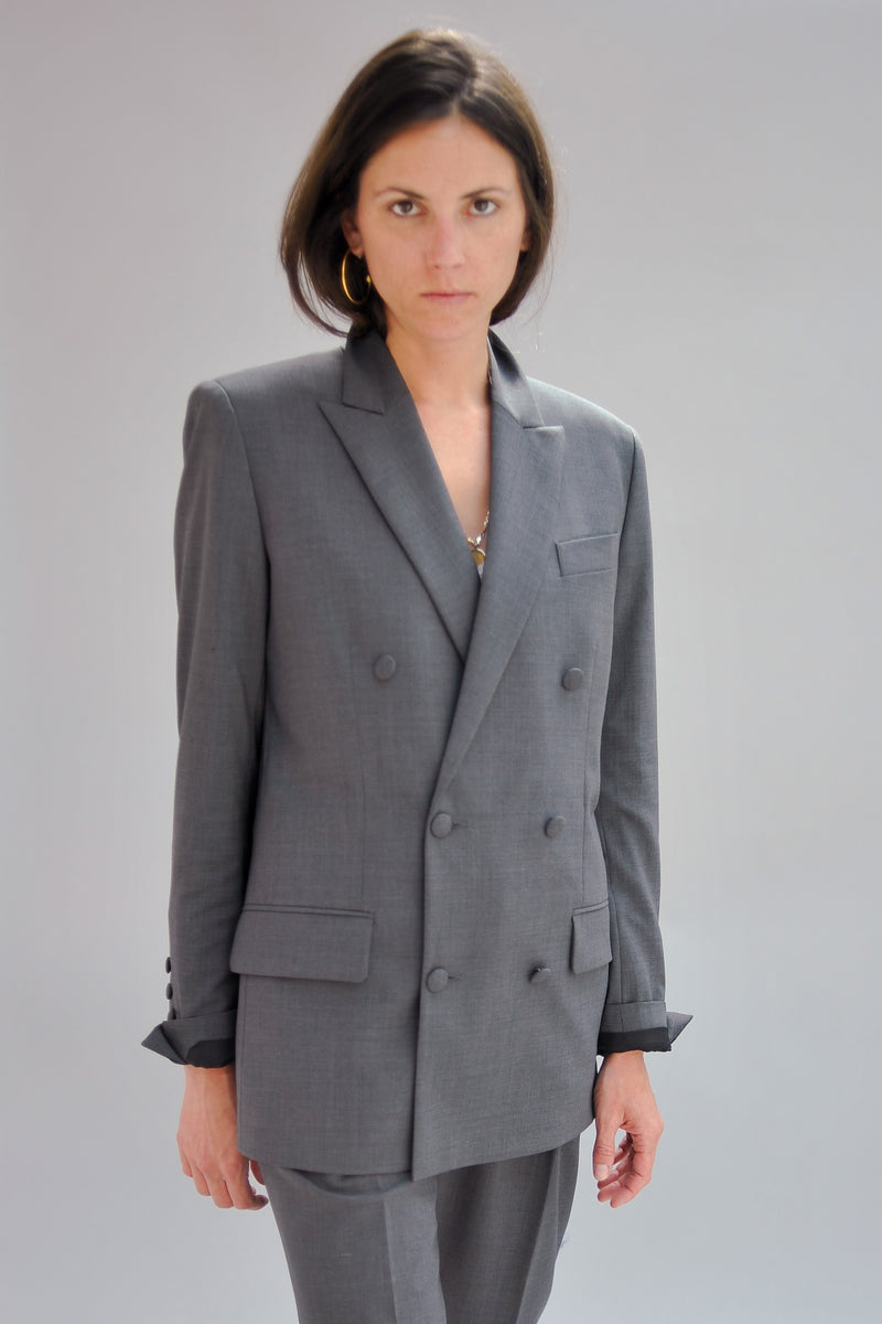 SARAH DE SAINT HUBERT grey double breasted boyfriend tailored jacket of light virgin wool with signature diagonal buttoned cuffs opening. Boyfriend and straight fit.
