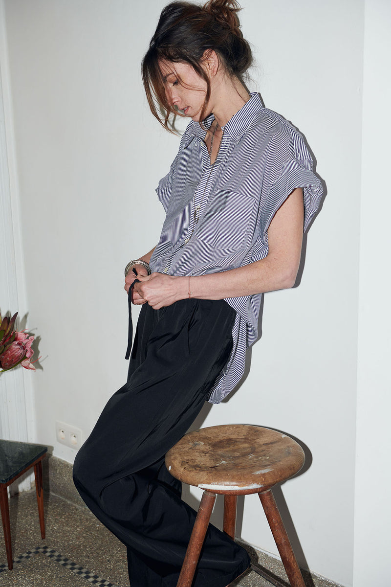 SARAH DE SAINT HUBERT oversized white with navy stripes shirt made of cotton with short rolled-up sleeves. Boyish and straight fit.
