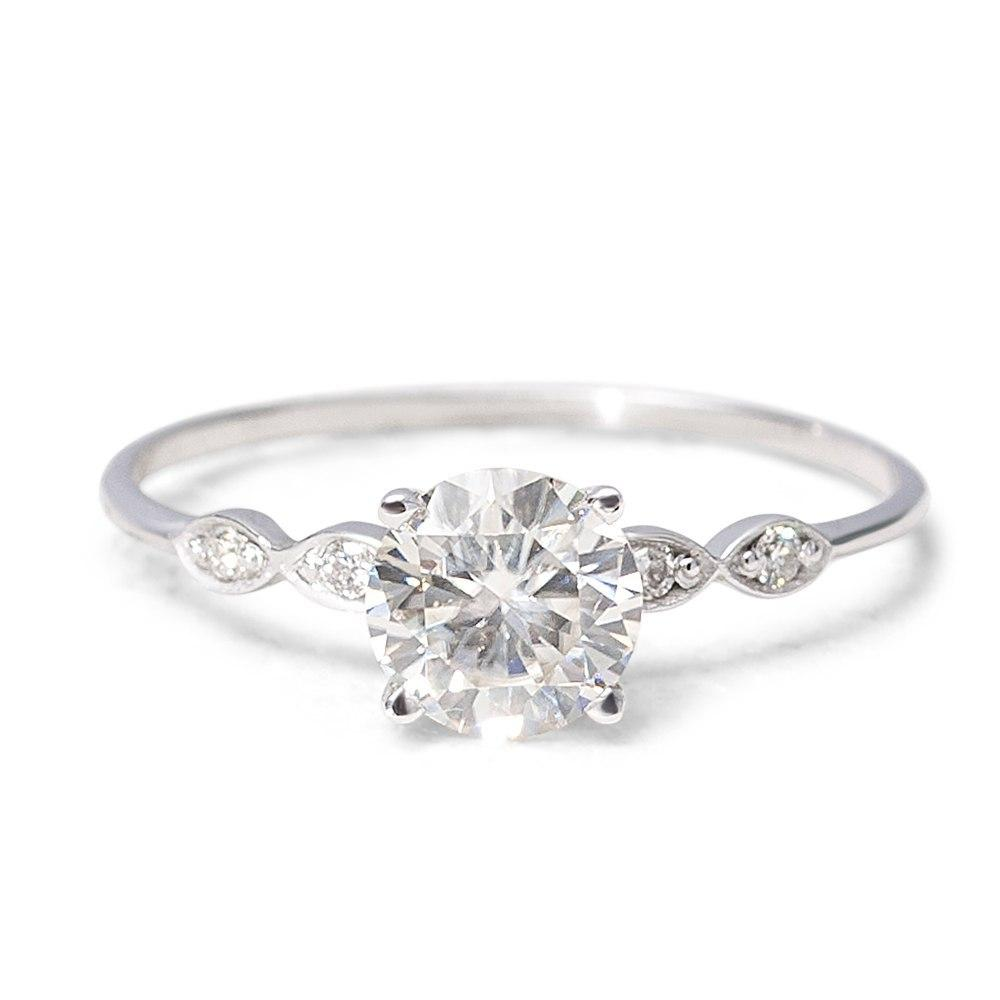 moissanite-ring-with-diamonds