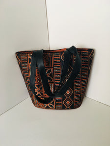 Handcrafted Handbag made out of Backcloth Material with Leather Material Handles.
