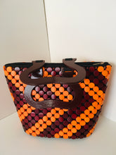 Orange and Brown colors Handcrafted Purse, made with wooden materials.