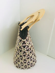 Brown and off white beaded handcrafted handbag with wooden handles.