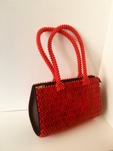 Solid Red, oval shaped, Handcrafted Beaded Handbag.