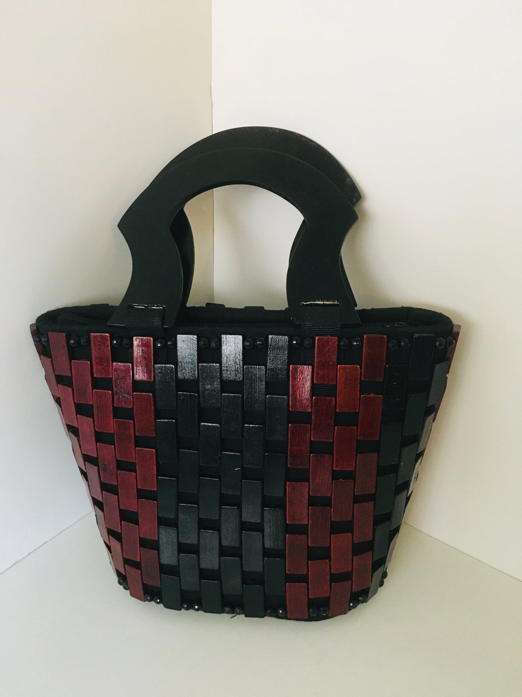 Coffee Brown and Black HandCrafted Handbag made out of wooden materials.