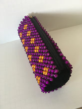 Gold and purple beaded clutch