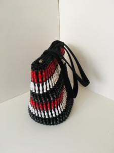 Solid Red, White and black Handcrafted Beaded Handbag with fabric handles.