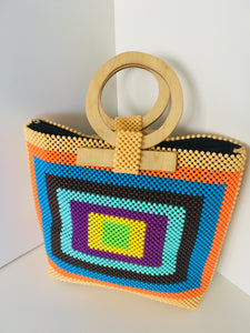 Multiple colored Handcrafted Beaded Purse with Wooden Handles.